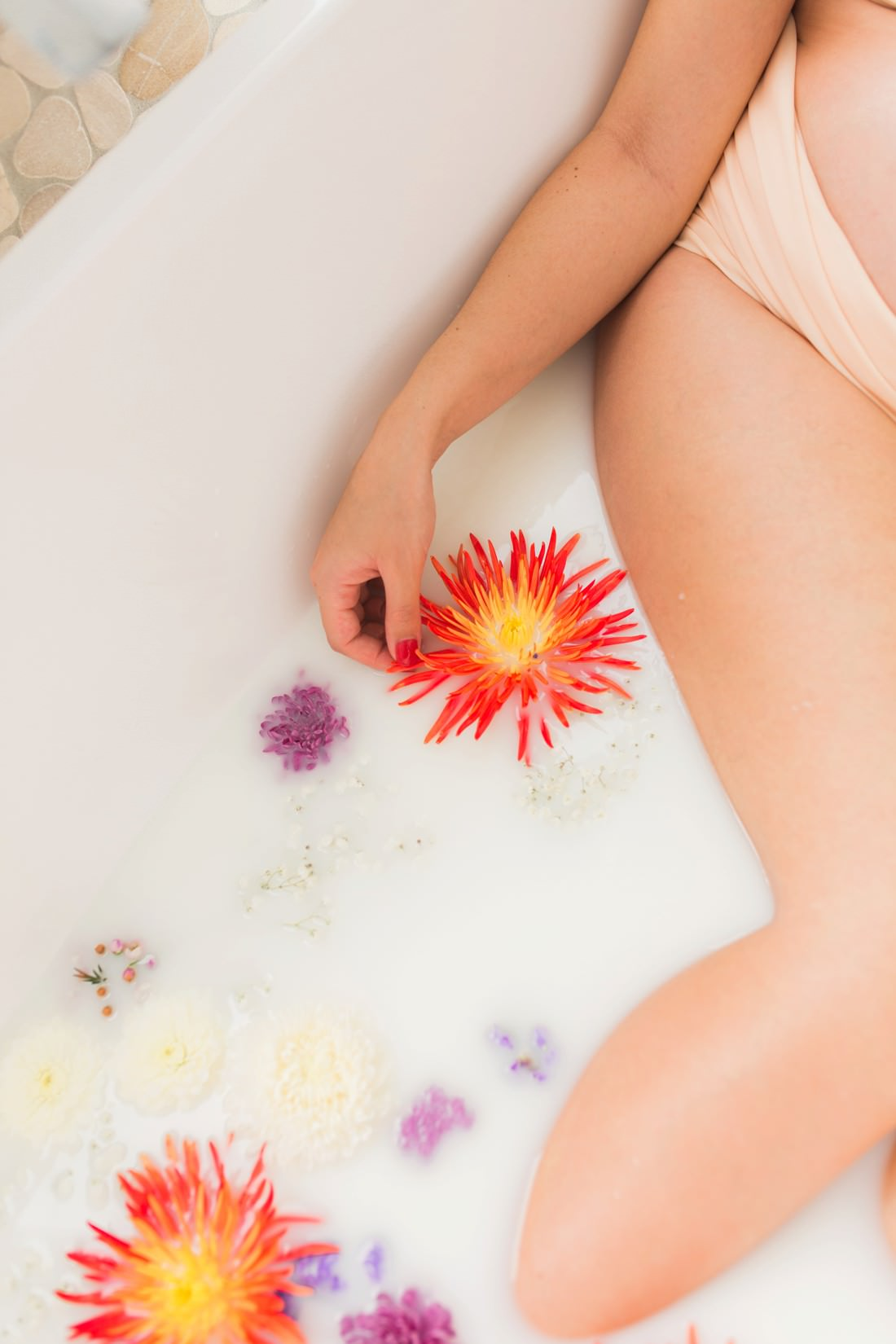 Milk bath pregnancy photoshoot by Mario Colli Photography